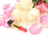 Roses and lipstick — Stock Photo