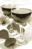 Wine and petals — Stock Photo