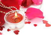 Petals and candle — Stock Photo