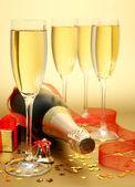 Champagne and confetti — Stock Photo