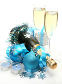 Champagne and New Year's decorations — Stock Photo