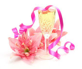 Wine, flowers, ribbon — Stock Photo