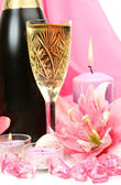 Champagne and lilies — Stock Photo