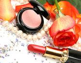 Decorative cosmetics and rose — Stock Photo