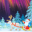 Santa travels in a sledge with reindeer — Stock Photo
