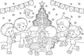 Children dancing around Christmas tree — Stock Photo
