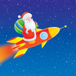 Santa Claus flies on a rocket - Stock Photo
