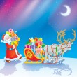 Santa loads Christmas gifts into his sleigh — Stock Photo #16189983