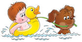 Puppy swimming and pulling a boy in a ducky float. — Stock Photo