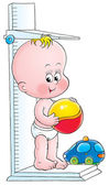 Baby standing on a height measuring scale — Stock Photo
