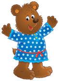 Happy bear in a blue polka dog dress — Stock Photo