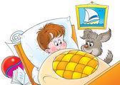 Hyper puppy beside a little boy's bed — Stock Photo