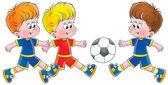 Three little boys running towards a soccer ball — Stock Photo