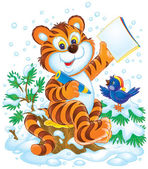 Smart tiger cub and bird in the snow — Stock Photo