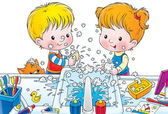 Children making a mess while washing their hands with soap — Stok fotoğraf