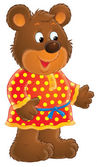Friendly bear in a red and yellow polka dog dress. — Stock Photo
