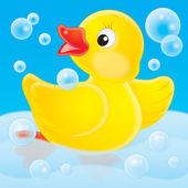Rubber duck dancing in blue bubbles — Stock Photo