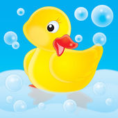 Cute yellow rubber duck posing in a tub — Stock Photo
