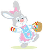 Easter Bunny with a basket of eggs — Stock Vector