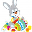 Stock Vector: Bunny paints Easter egg