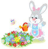 Easter Bunny watering flowers — Stock Vector