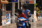 Boys on a moped. Celebration of water festival in Thailand — Stock Photo