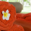Three towels and Frangipani flower — Stock Photo