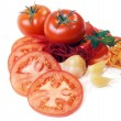 Stock Photo: Tomatoes abd garden-stuff isolated on white