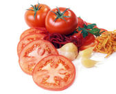 Tomatoes abd garden-stuff isolated on white — Stock Photo
