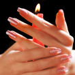 Stock Photo: Woman's hand with candle