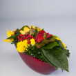 mixed flower arrangement in bright colors — Stock Photo