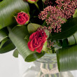 Beautiful bouquet of  roses with green leaves — Stock Photo