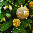 Decorations on a christmas fur-tree — Stock Photo