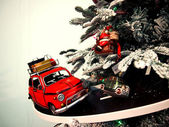 Toy car rides on the road around the Christmas tree — Stock Photo