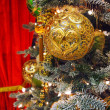 Golden decorations on the  christmas tree — Stock Photo