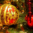 Red decorations on the  christmas tree — Stok fotoğraf