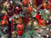 Red decorations on the Christmas tree — Stock Photo