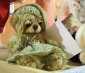 Teddy bear in hat and dress — Stock Photo