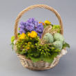 Easter basket with freesia, hyacinth and quail eggs — Stock Photo