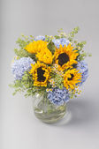 Bouquet of sunflowers, hydrangeas and field daisies — Stock Photo