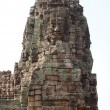 Carved stone faces at  temple in Angkor Wat — Stockfoto #51655363