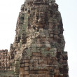 Carved stone faces at temple in Angkor Wat — Stock fotografie