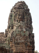 Carved stone faces at  temple in Angkor Wat — Stock Photo