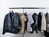 Women's jackets on hangers — Stock Photo