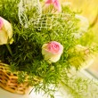Beautiful bouquet of white and pink roses in a basket — Stock Photo