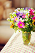 Bouquet of simple flowers on the table — Stock Photo
