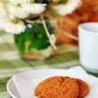 Still life of home-baked oatcakes, tea, and chrysanthemums — Stock Photo