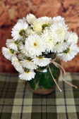 Still life of chrysanthemums in small vase. Rustic style — Stock Photo