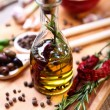 Olive oil with spices — Stock Photo