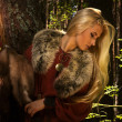 Постер, плакат: Scandinavian girl with fur skins
